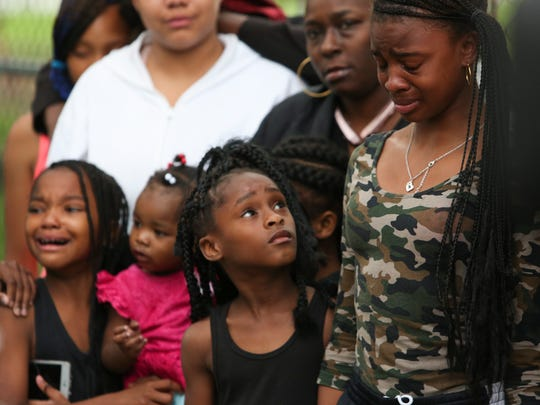 Young relatives of a 6-year-old boy who was shot and critically wounded break down in tears during a prayer vigil Wednesday in Wilmington.