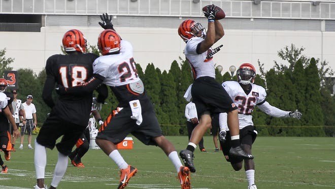 Cincinnati Bengals free safety Derron Smith intercepts a pass intended for wide receiver A.J. Green during a drill on Wednesday in training camp.
