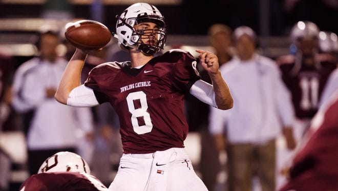 Dowling Catholic's J.T. Brown throws against Johnston Johnston during their game at Valley Stadium in West Des Moines on Friday, October 9, 2015.