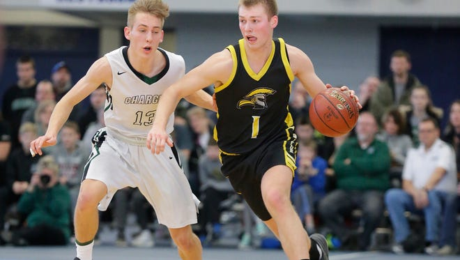 Waupun's Marcus Domask drives down the court against Kettle Moraine Lutheran during a WIAA Division 3 sectional championship game March 10 in Whitefish Bay.