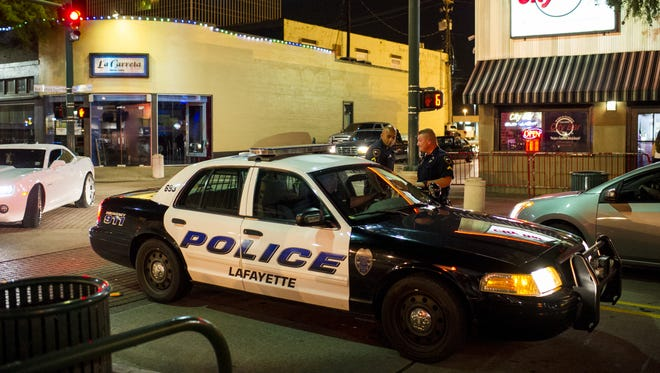 A Lafayette Police Department officer drives his unit through the intersection of Jefferson Street and Garfield Street near City Bar Downtown while on patrol in downtown Lafayette, LA, Friday, June 27, 2014.   Photo by Paul Kieu, The Advertiser