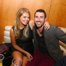 Kate Upton. left, with Justin Verlander in January 2014. The couple appears to victims of a celebrity nude photo leak over the weekend.