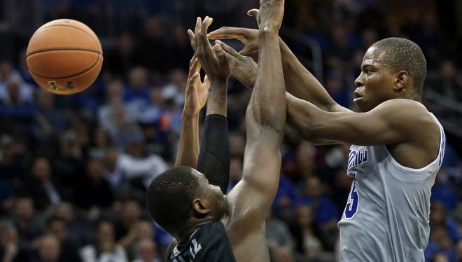 Seton Hall guard Isaiah Whitehead (15) makes a pass over Providence forward Ben Bentil (0) during the second half of an NCAA college basketball game Thursday, Feb. 25, 2016, in Newark, N.J. Seton Hall won 70-52. (AP Photo/Mel Evans)