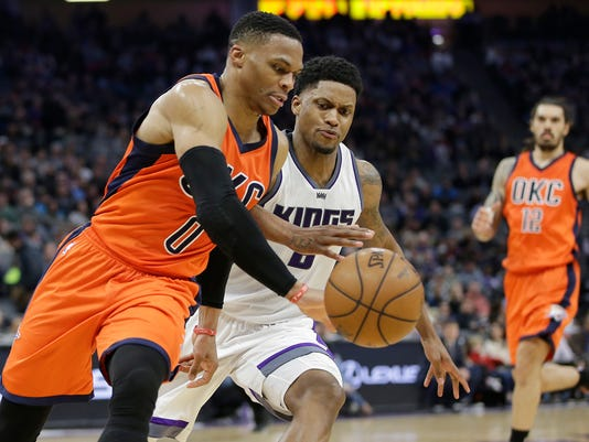 Oklahoma City Thunder guard Russell Westbrook, left, out races Sacramento Kings forward Rudy Gay for the ball during the first half of an NBA basketball game Sunday, Jan. 15, 2017, in Sacramento, Calif. (AP Photo/Rich Pedroncelli)