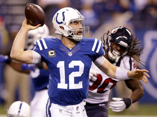 Indianapolis Colts quarterback Andrew Luck (12) scrambles away from Houston Texans defensive end Jadeveon Clowney (90) in the second half of  their NFL football game Sunday, December 11, 2016, afternoon at Lucas Oil Stadium. The Colts lost to the Texans 22-17.