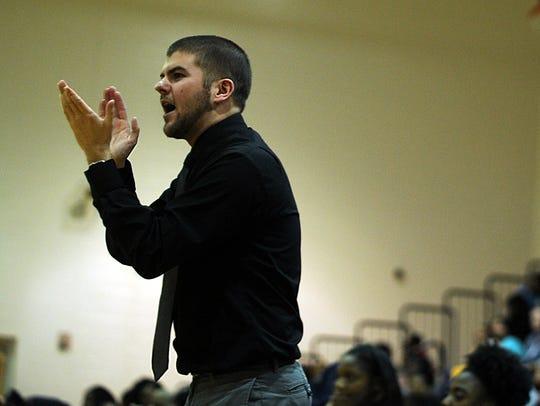 Pocomoke head coach Corey Zimmer cheers on his team