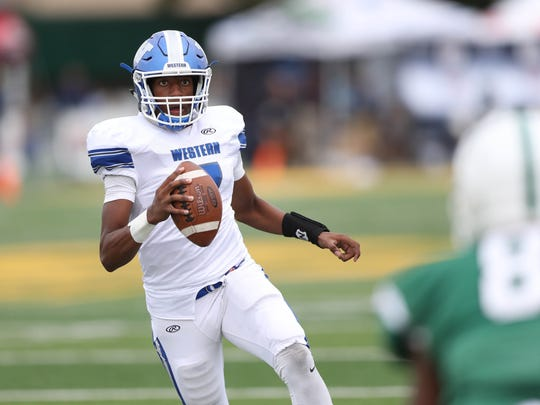 Walled Lake Western quarterback Sam Johnson runs the ball during the second half of the 19-14 win over West Bloomfield on Thursday, Aug. 24, 2017, at Wayne State.
