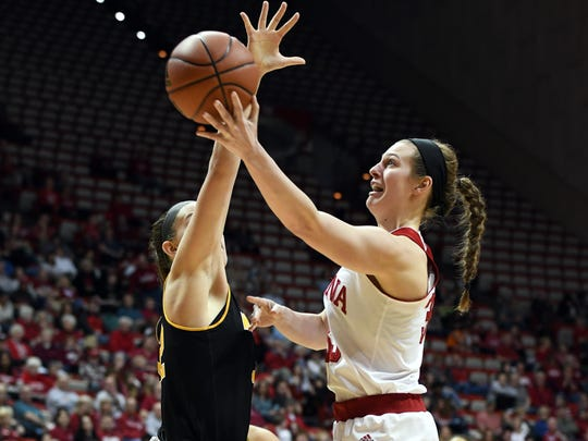 Indiana Hoosiers forward Amanda Cahill (33) attempts a layup against Milwaukee at Simon Skjodt Assembly Hall in Bloomington, Ind., on Sunday, March 18, 2018.