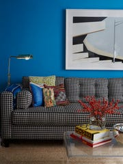 Renovated living room has the same shade of blues as