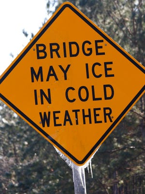 This file photo shows icicles hanging on a warning sign in Mississippi.