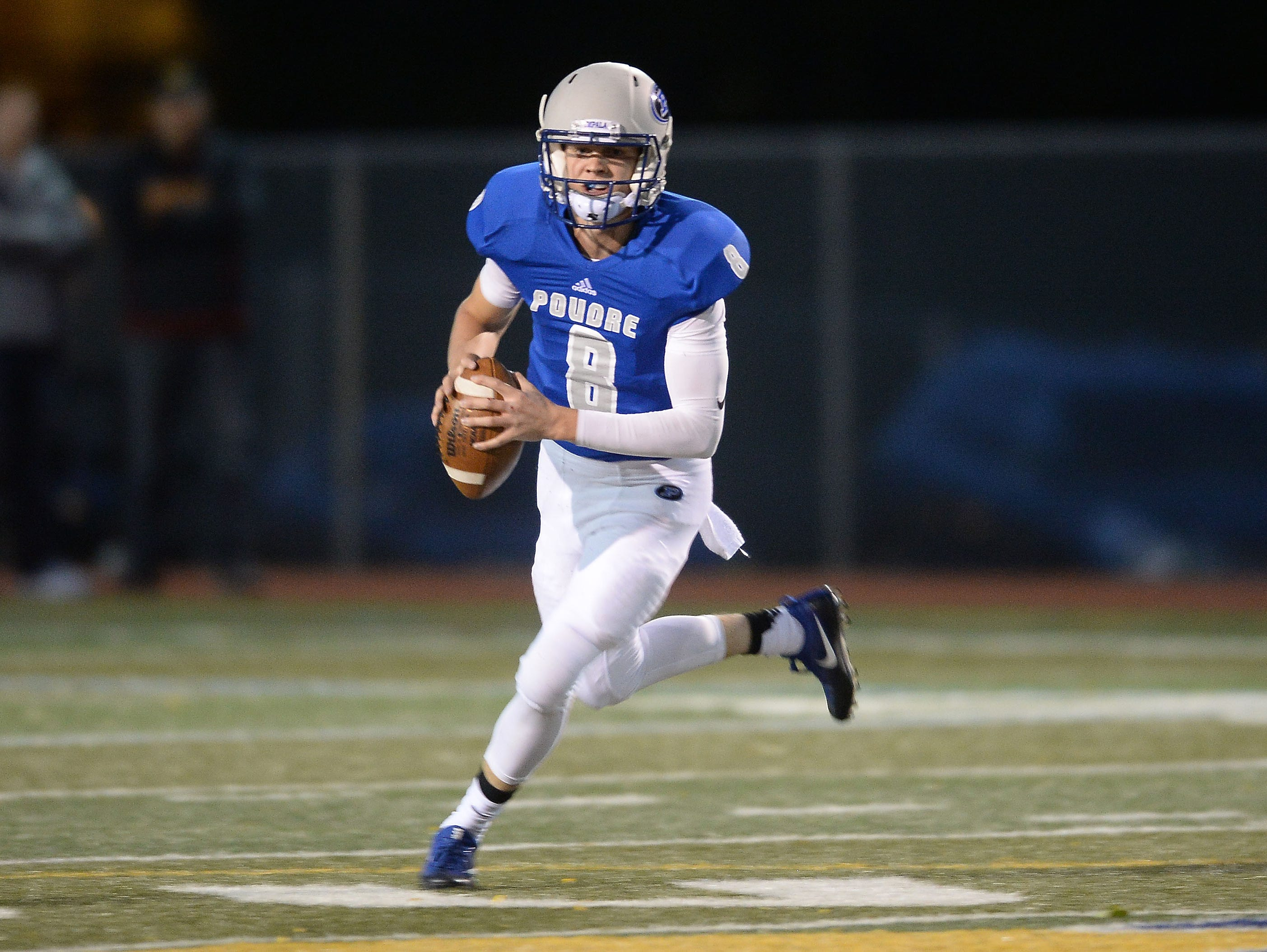 Poudre High School quarterback James Campbell looks for an opening in a game against Rocky Mountain High School on Friday. The Impalas won 13-6.