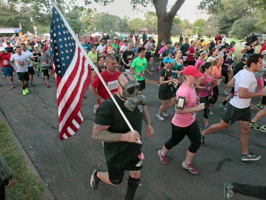 Darth Vader, 43, Canandaigua, carries the American