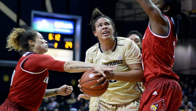 Louisville guard Briahanna Jackson (0) knocks the out of the hands of Vanderbilt forward Kayla Overbeck, center, as forward Myisha Hines-Allen, right, defends during the first half of an NCAA college basketball game, Wednesday, Dec. 21, 2016, in Nashville, Tenn.