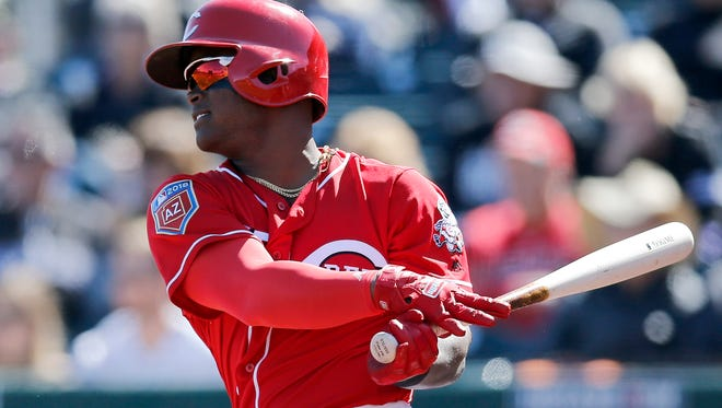 Cincinnati Reds second baseman Dilson Herrera (15) singles on a line drive to center field in the bottom of the first inning of the Spring Training game between the Cincinnati Reds and the Colorado Rockies at Goodyear Ballpark in Goodyear, AZ, on Saturday, Feb. 24, 2018.