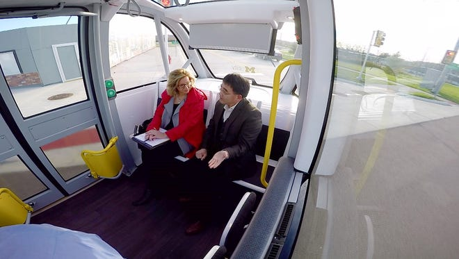 Carol Cain with Huei Peng, director of the University of Michigan Mobility Transformation Center, rides in the Navya Arma, an autonomous shuttle on Nov. 15, 2016. The French company announced during a press conference on Friday, Dec. 9, 2016 that it will keep the shuttle at Mcity, where further research and testing will take place. Mcity is owned and operated by UM.