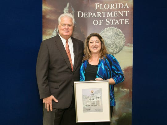Left to right: Secretary of State of Florida Ken Detzner and Dr. Scott-Ireton
