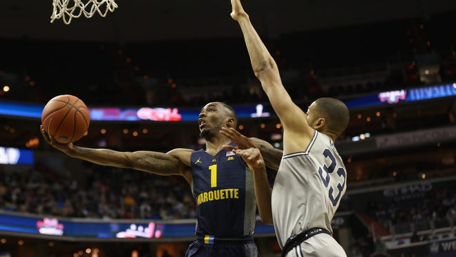 Marquette Golden Eagles guard Duane Wilson (1) shoots the ball as Georgetown Hoyas forward Trey Mourning (33) defends in the first half at Verizon Center.