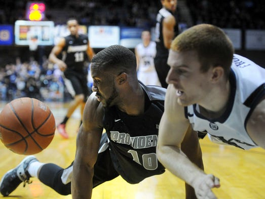 Kadeem Batts of Providence and Erik Fromm of Butler dive for a loose ball that was headed out of bound. Butler hosted Providence in Big East basektball Sunday February 23, 2014 at Hinkle Fieldhouse. Providence won 87-81.