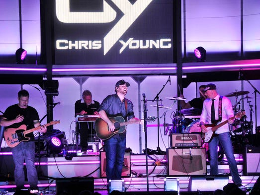 Chris Young performs for his fan club party aboard the General Jackson Showboat in Nashville, Tenn. June 5, 2014.