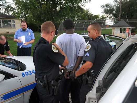 One of the  juveniles that escaped from the Woodland  Youth Development Center is brought in handcuffed by Metro police on Tuesday Sept. 2, 2014, in Nashville in Tenn.