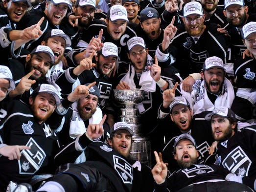 Los Angeles Kings players pose for a team photo with the Stanley Cup after defeating the New York Rangers game five.