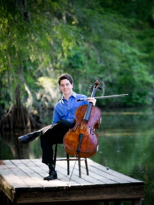 John-Henry Crawford is seen with a 200-year-old cello that has passed through at least three generations of his family. He is with it in Moscow now to take part in the 2015 Tchaikovsky International Competition.