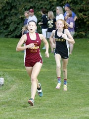 Ithaca's Lizzy Rayle leads Corning's Claire Mason on their way to a 1-2 finish in the girls race at the 2017 STAC West championships at Pirozzolo Park in West Elmira.