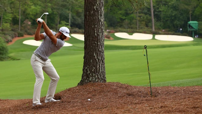 Dustin Johnson plays a shot from the straw on the 13th hole during a practice round at Augusta National Golf Club. Mandatory Credit: Rob Schumacher-USA TODAY Sports