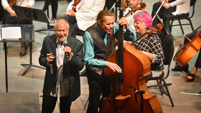 Corky Siegel, front left, and Bram Wijnands are shown during a spontaneous jamming session during one of last year's Festival Symphony Orchestra concerts.