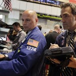 Traders work the floor at the New York Stock Exchange.