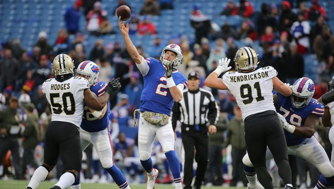 Bills rookie quarterback Nathan Peterman looks downfield against the Saints. Peterman saw his firs regular season action late in a 47-10 blowout loss to New Orleans 47-10.