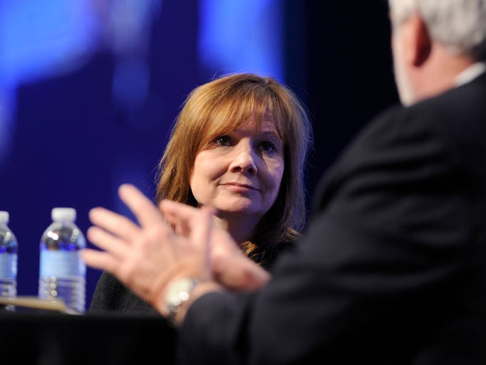 Mary Barra, CEO of General Motors, talks with Keith