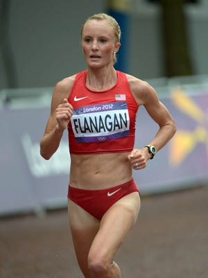 In a file photo from Aug. 3, 2012, Shalane Flanagan (USA) runs in the women's at the London Olympics.
