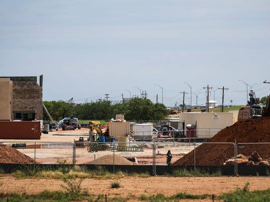 Crews continue to work on construction of a new H-E-B