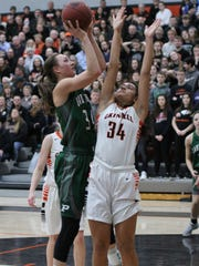 Grinnell Tiger Sienna Durr, 34, tries to block a shot by Pella's Emily Holterhaus, 34, during Grinnell's 84-47 regional final win at Grinnell on Wednesday, Feb. 21.