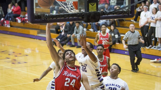 Richmond's AJ Ferguson goes in for the layup during the game Friday evening against Muncie Central at Muncie Fieldhouse.