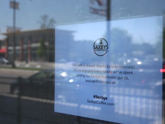 """The sign on the door at Saxbys Coffee in College Town in Rochester Monday, May 23, 2016.  It reads """"The cafe is closed, thanks for your business! We've enjoyed every minute we've spent serving our Saxbys Rochester guests, and we'll miss you all."""""""