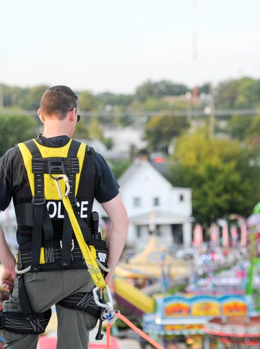 An officer of the EPD SWAT team looks over the crowd