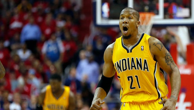 Indiana Pacers forward David West (21) celebrates against the Washington Wizards in the fourth quarter in game six of the second round of the 2014 NBA Playoffs at Verizon Center. The Pacers won 93-80, and won the series 4-2.