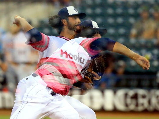 Hooks' Ralph Garza pitches against Arkansas on Saturday, July 8, 2017, at Whataburger Field in Corpus Christi.
