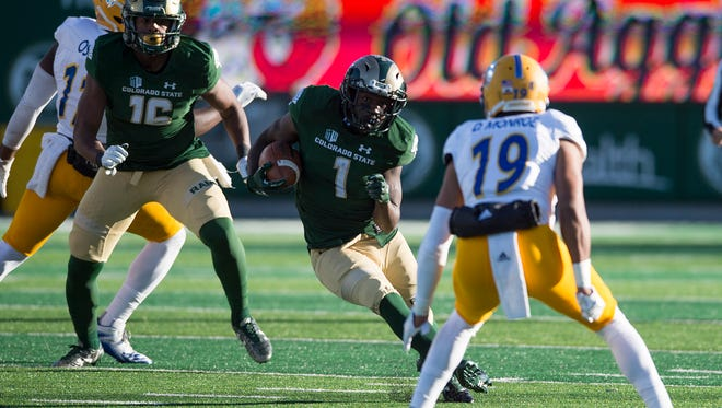 CSU running back Dalyn Dawkins runs through the San Jose State defense for some of his 138 rushing yards during Saturday's 42-14 win over the Spartans at the Rams' on-campus stadium.