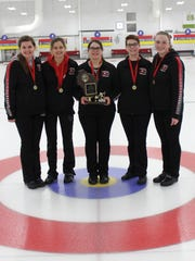 Members of the high school girls curling state championship from Stevens Point display the championship trophy after claiming a second consecutive title last weekend.