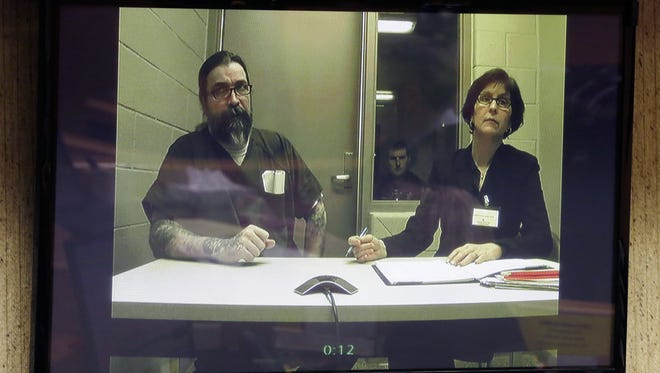 Brian T. Flatoff appears on a video monitor in February in Winnebago County Circuit Court. Attorney Colleen Bradley withdrew from the case, and Flatoff is awaiting the appointment of a new attorney.