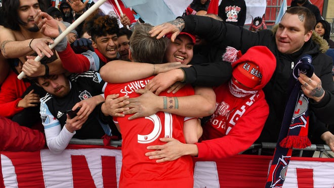 Chicago Fire midfielder Bastian Schweinsteiger reacts with fans after defeating the New York Red Bulls at SeatGeek Stadium.
