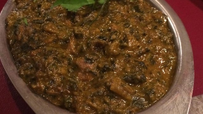 Saag dish, spinach with tender goat, roasted on the bone.