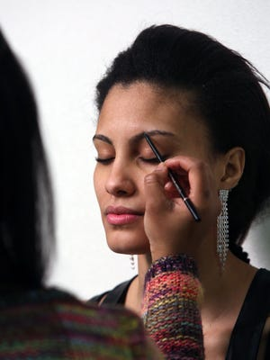 Model Mariaelena Perez of Yonkers has make-up applied by Deborah Cadore for a photo shoot in Spring Valley April 16, 2015.