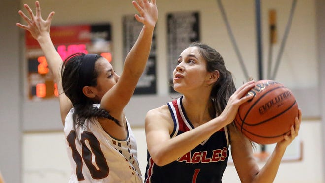 Veterans Memorial's Victoria Arismendi takes the ball to the basket against Alice's Jakki Barrera during the 30-5A girls interzone playoff game on Friday, Feb. 10, 2017, at Alice High School in Alice.