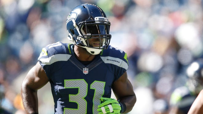 Sep 27, 2015; Seattle, WA, USA; Seattle Seahawks strong safety Kam Chancellor (31) participates in pre game warmups against the Chicago Bears at CenturyLink Field.