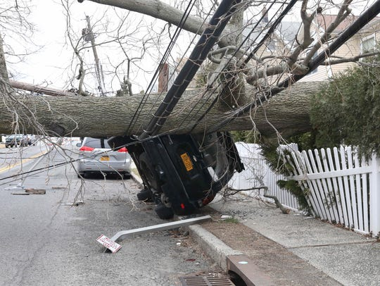 A huge tree took down a power pole and overturned this