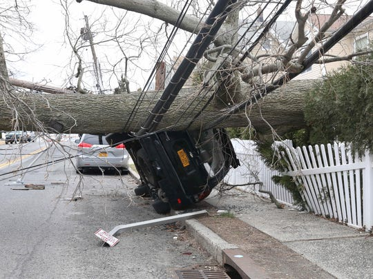 A huge tree took down a power pole and overturned this car on Keeler Avenue and Florence Street in Mamaroneck as seen March 5, 2018.